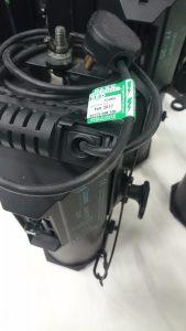 PAT test green sticker on theatre light