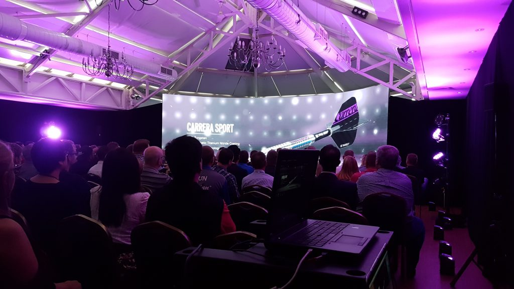 Manor of groves darts event purple lighting to match brand for product launch event