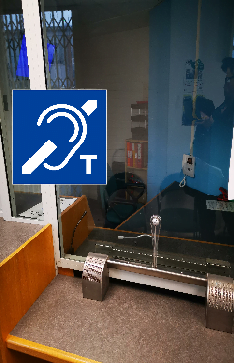 Through glass hearing induction loop installation with robust speakers outside and microphone