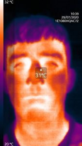 Thermal image head shot of a person showing temperature hotspots on face